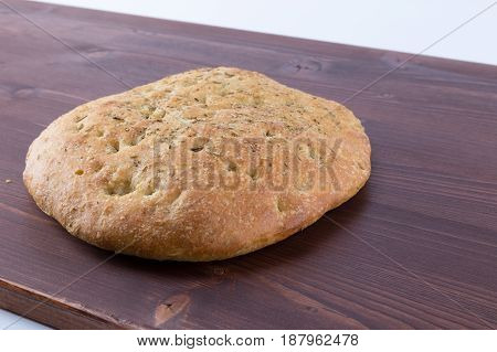 Focaccia Italian Flat Bread With Rosemary On An Ipe Natural Wood Table