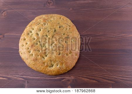 Focaccia Italian Flat Bread With Rosemary On An Ipe Natural Wood Table - Top View