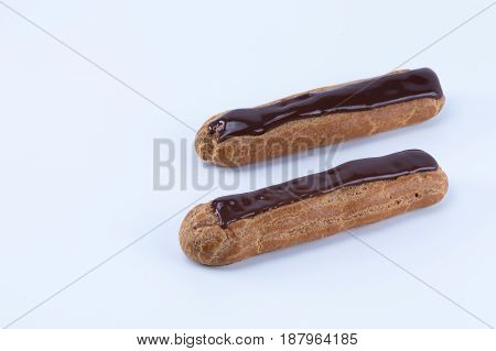 Two Delicious Parallel French Chocolate Eclairs  Isolated In White Background