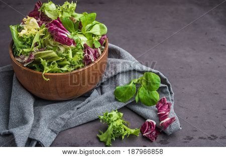 Salad mix with rucola. Fresh vegetable salad healthy food salad leaves. Dietary food concept. Vegetable background.
