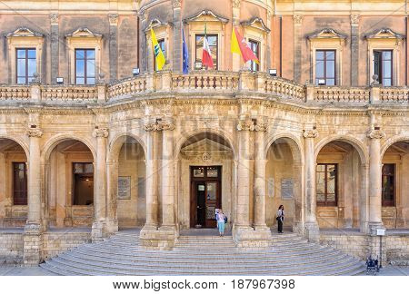 The facade and recessed loggia of Palazzo Ducezio the Town Hall (Municipio) nowadays - Noto Sicily Italy, 18 October 2011