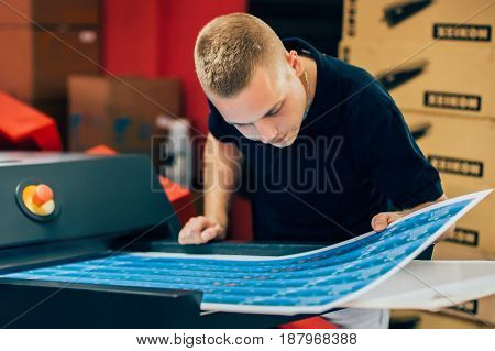 Young Man Working In Printing Factory