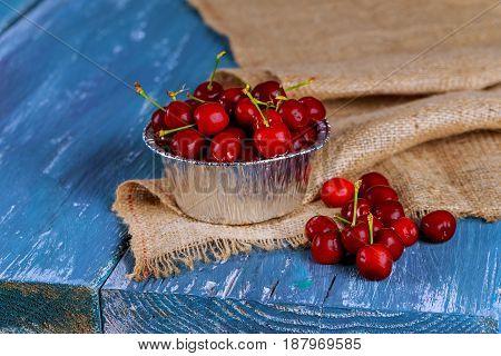 Fresh Cherries In An Old Metal Mug. Fresh Cherries Metal Mug On Old Wooden Table.