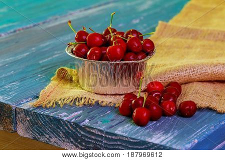 Some Ripe Cherries With Sparkling Water Drops In Small Basket Old Wooden Table
