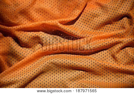 Close Up Of Orange Polyester Nylon Sportswear Shorts To Created A Textured Background