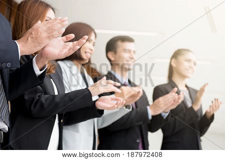 Business people clapping their hands in the meeting congratulation and appreciation concepts