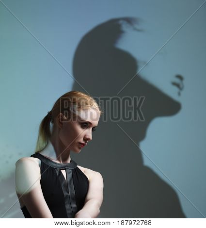 Fashion art studio portrait of elegant naked lady with shadow on her body.