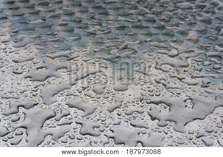 Abstract Texture Of Liquid Droplets On Metal Surface