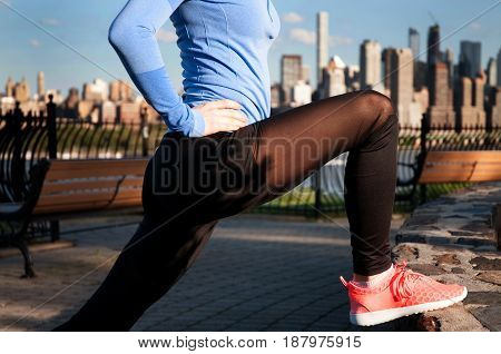 Woman Stretching Before Fitness In Park View Manhattan