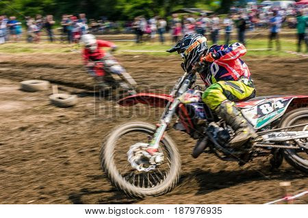 Mx Rider Turns In A Dirt. Motion Blur With Flying Dirt