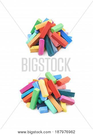 Pile of colorful pastel crayon chalks isolated over the white background, set of two different compositions