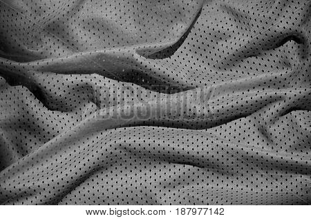 Grey Sport Clothing Fabric Texture Background. Top View Of Grey Cloth Textile Surface. Dark Basketba