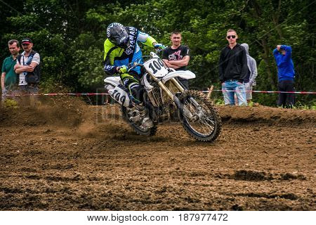 Enduro Bike Rider Accelerating In Dirt Track