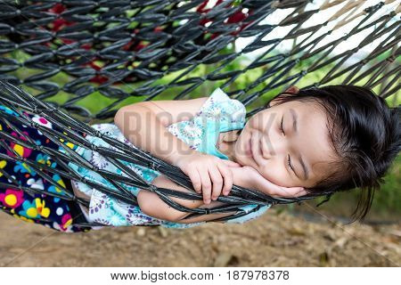 Happy Child Enjoying And Relaxing In Hammock, Sweet Dream And Smiling.