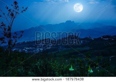 Night Sky With Cloudy And Sunbeam, Foggy Is Swingin Above Mountain Peak.