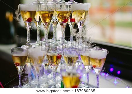 Close up glasses of champagne stacked as pyramid at party