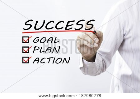 Businessman hand writing success Business concept. goal plan action