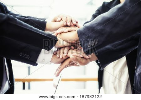 business people meeting and joining hands together teamwork concept soft focus vintage tone