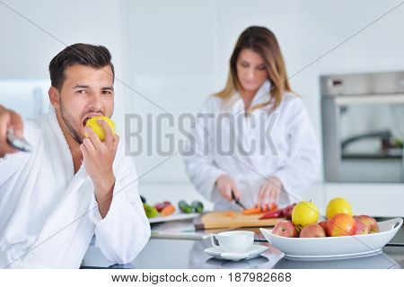 Couple having breakfast together at the kitchen.