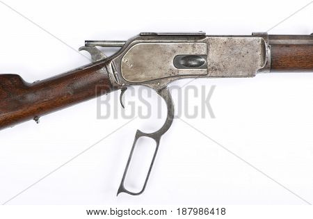 Antique 1876 Cowboy lever action rifle in cocked hammer position.