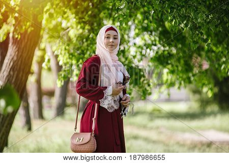 Smiling girl in hijab happy Muslim woman in summer in the park