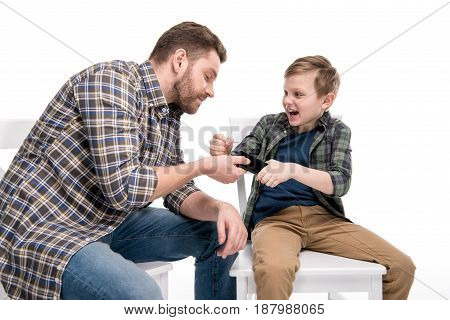 Father And Emotional Little Son Quarreling About Smartphone, Family Problems Concept