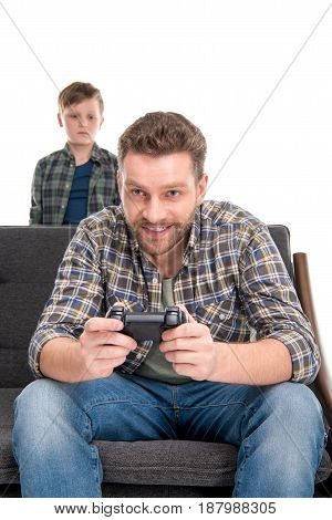 Little Boy Looking At Father Sitting On Sofa And Playing With Joystick, Family Problems Concept
