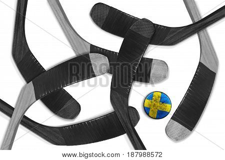 Hockey sticks and a Swedish puck on a white background. Hockey concept