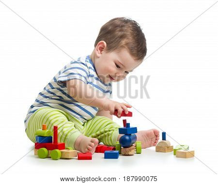Smiling baby boy playing with blocks toys isolated on white background.