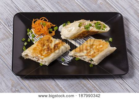 Pita bread wrapped with cottage cheese and vegetables close up