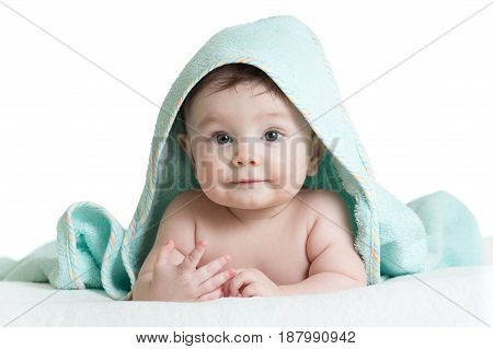 Funny happy baby boy in towel isolated on white background