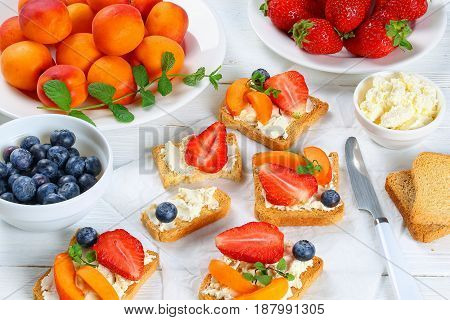 Strawberry Apricot Blueberry Crisp Open Toasts