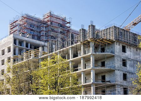 construction of a modern multi-storey residential building on sunny day