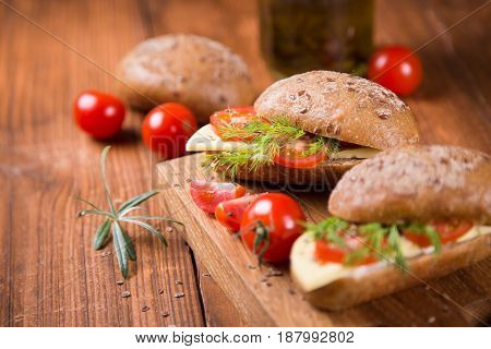 healthy breakfast-sandwich with tomato and cheese in studio