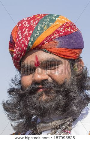 JAISALMER INDIA - FEBRUARY 08 2017 : Unidentified men wearing traditional Rajasthani dress participate in Mr. Desert contest as part of Desert Festival in Jaisalmer Rajasthan India. Close up
