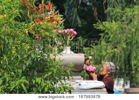 HO CHI MINH CITY VIETNAM - NOVEMBER 28, 2016: Unidentified woman prays at Vinh Nghiem pagoda temple Ho Chi Minh City Saigon Vietnam