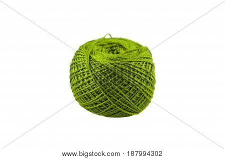 ball of green color of cotton threads for knitting on a white background