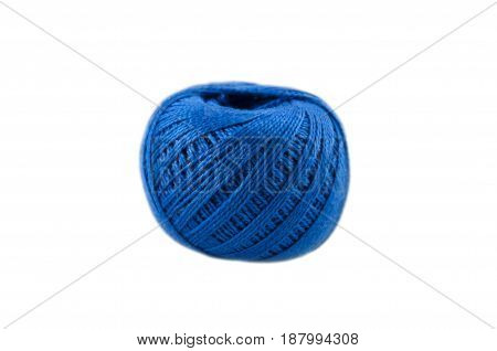 ball of blue color of cotton threads for knitting on a white background