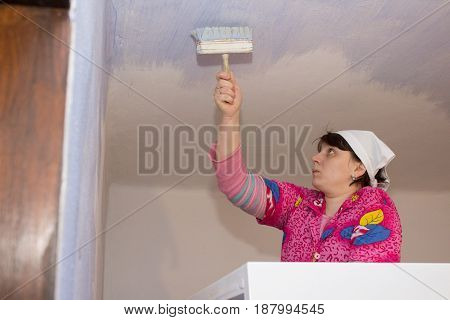 Rural woman painted ceiling in the room