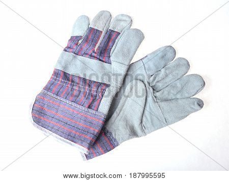 Pair of grey protective work gloves isolated on a white background