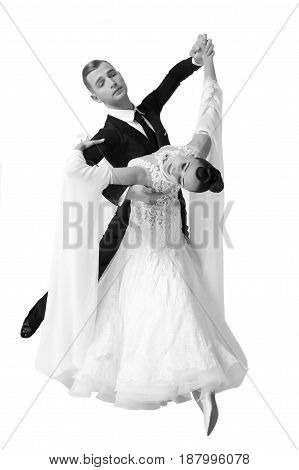 ballroom dance couple in a dance pose isolated on white background. sensual professional dancers dancing walz tango slowfox and quickstep. Black and white