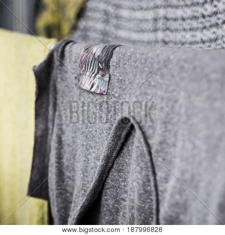 Wet clothes hanging on the dryer near the window