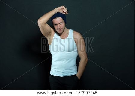 Portrait Of Handsome Bearded Man In Hat On Black Background