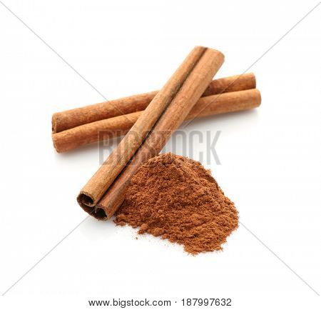 Cinnamon sticks and powder isolated on white, closeup
