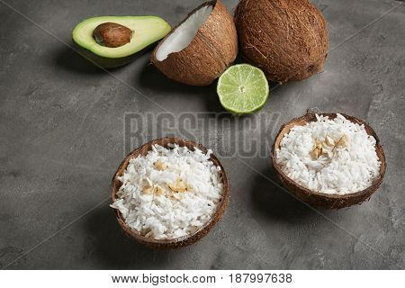 Tasty rice in coconut shell on table