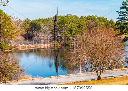 Landscape with Stone Mountain Lake and Carillon in the Stone Mountain Park in sunny autumn day Georgia USA