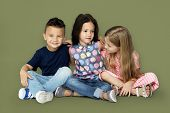 Group of little children smiling and huddle together poster