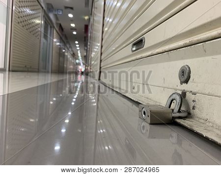 Warehouse Of Retail Merchandise Shop Combination Lock On A Self Storage Door With White Storage Unit