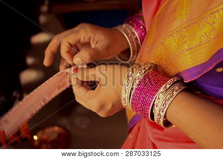 Bridal Makeup-a Photograph Taken Of A Typical Indian Bride As Colourful Saree And Bangles Made Her L