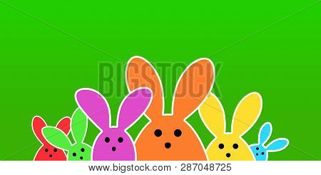 Colorful Easter Bunny As Illustration On Green Background. Easter Background For The Colorful Easter